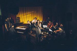 MNOE - 14-piece orchestral pop ensemble with Lauren Deming